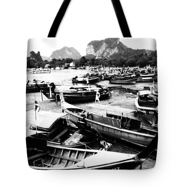 Beached Longboats Tote Bag by Justin Woodhouse