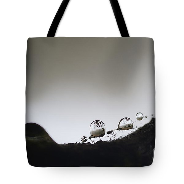 Beads Of Rain With Particles Floating Tote Bag by Dan Friend