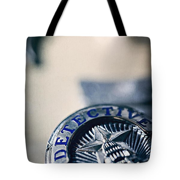 Tote Bag featuring the photograph Behind The Badge by Trish Mistric