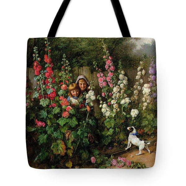 Behind The Hollyhocks Tote Bag by Charles Hunt