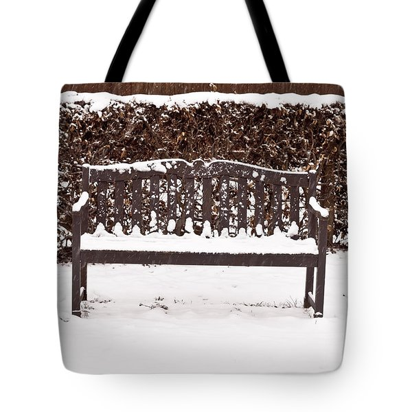 Bench In The Snow Tote Bag by Tom Gowanlock
