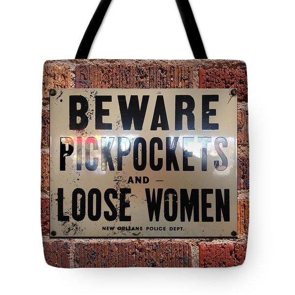 Beware Pickpockets And Loose Women Sign On Brick Wall Tote Bag