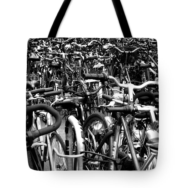 Tote Bag featuring the photograph Sea Of Bicycles- Karlsruhe Germany by Joey Agbayani