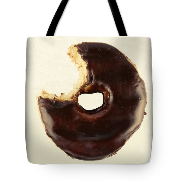 Tote Bag featuring the photograph Chocolate Donut With Missing Bite by Vizual Studio