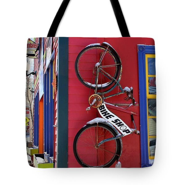 Tote Bag featuring the photograph Bike Shop by Fiona Kennard