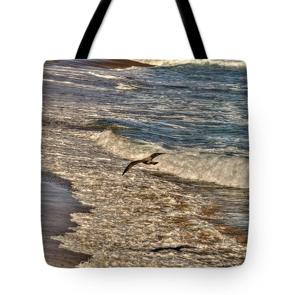 Tote Bag featuring the pyrography Bird Gliding Over Seashore by Julis Simo