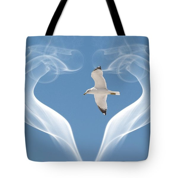 Tote Bag featuring the photograph Bird In Flight by Athala Carole Bruckner