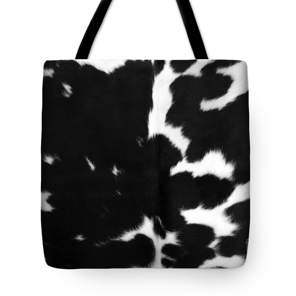 Tote Bag featuring the photograph Black Cowhide by Gunter Nezhoda