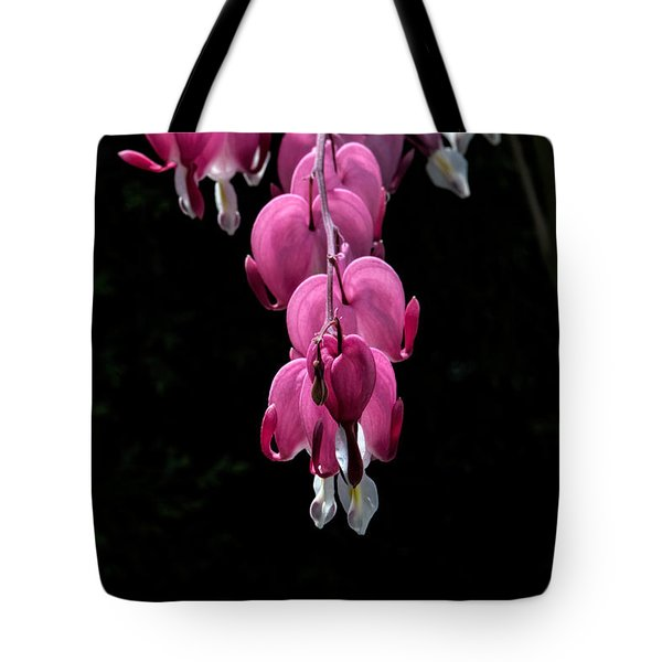 Tote Bag featuring the photograph Bleeding Hearts by Leif Sohlman