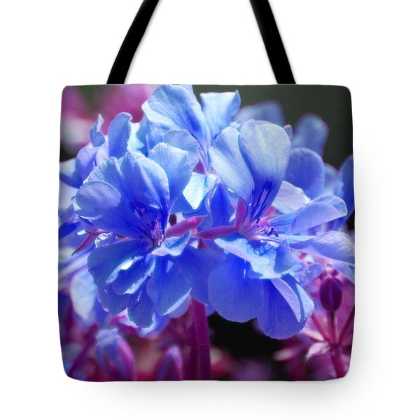 Tote Bag featuring the photograph Blue And Purple Flowers by Matt Harang