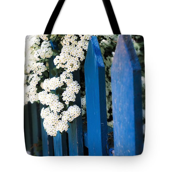 Blue Garden Fence With White Flowers Tote Bag