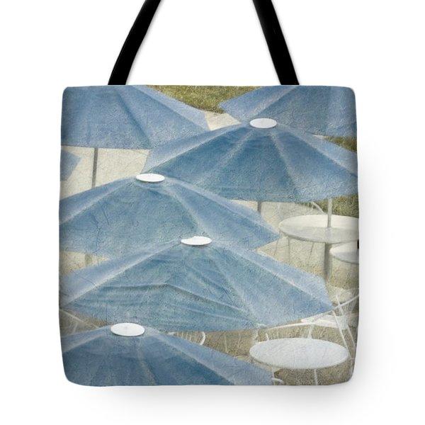 Blue Umbrellas And A Cola Tote Bag
