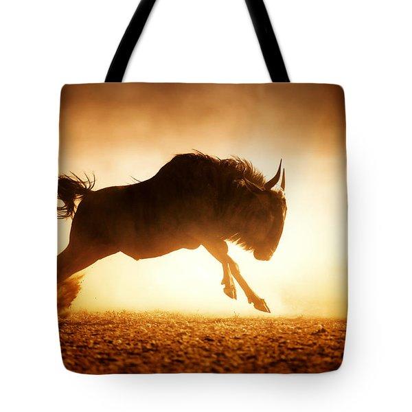 Blue Wildebeest Running In Dust Tote Bag