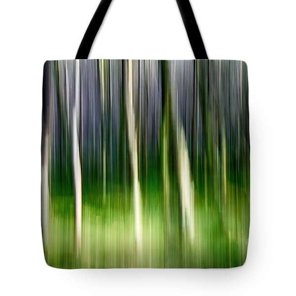 Tote Bag featuring the photograph Blurred by Juergen Klust