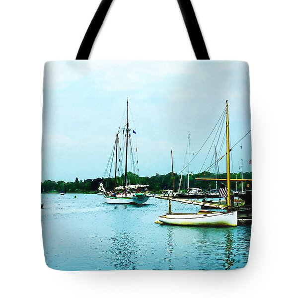 Tote Bag featuring the photograph Boats On A Calm Sea by Susan Savad