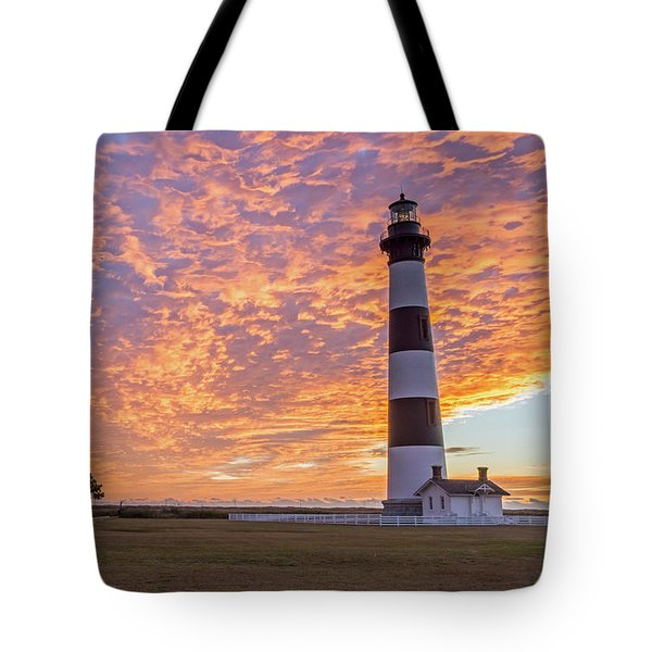 Bodie Island Lighthouse At Sunrise Tote Bag by Photographic Arts And Design Studio