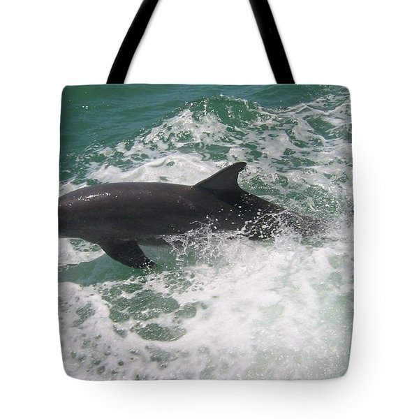 Tote Bag featuring the photograph Bottlenose Dolphin Catching A Wave by Jean Marie Maggi