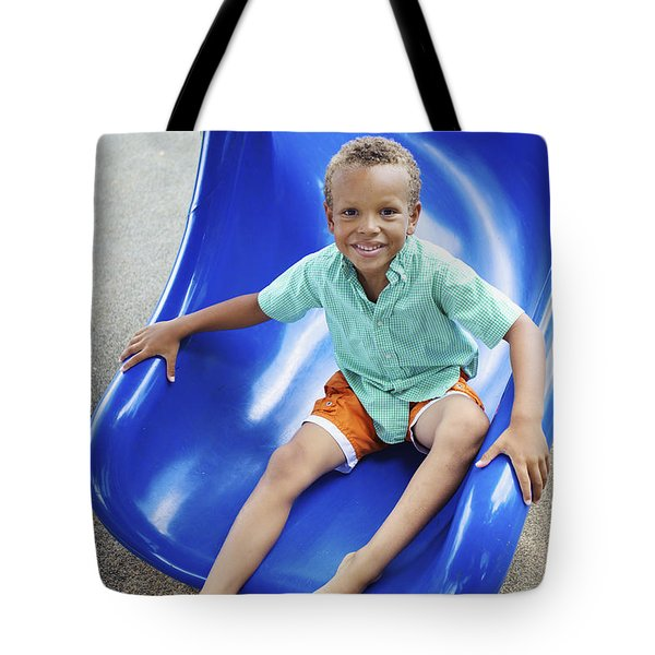 Boy On Slide Tote Bag by Kicka Witte