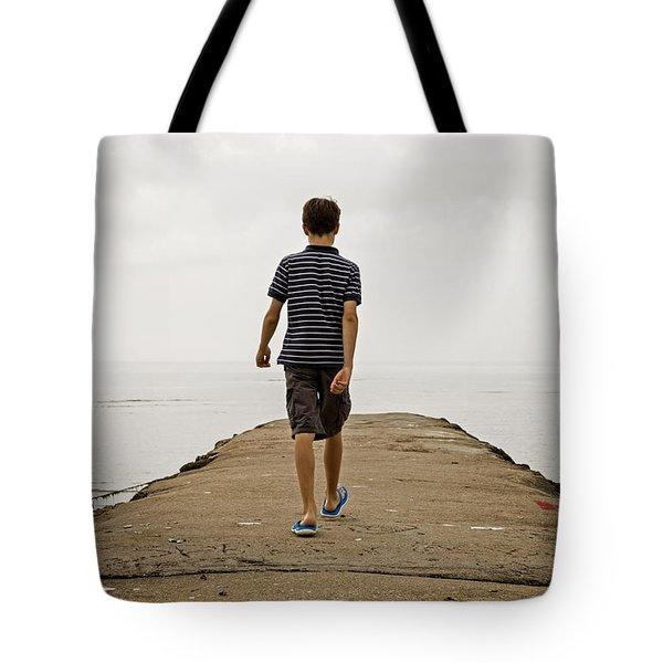 Boy Walking On Concrete Beach Pier Tote Bag by Edward Fielding
