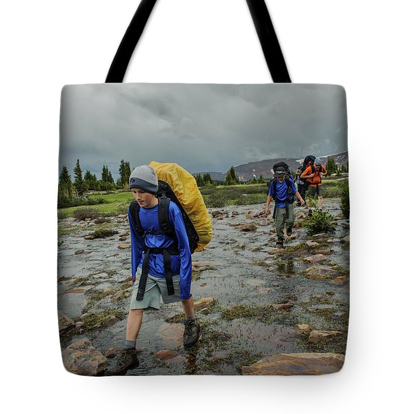 Boys Cross Streams During A Backpack Tote Bag