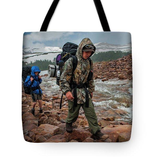 Boys Hike Along The Rocky Shore Tote Bag