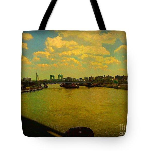 Bridge With Puffy Clouds Tote Bag by Miriam Danar