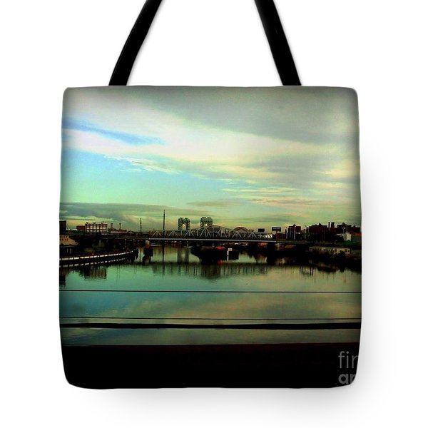 Tote Bag featuring the photograph Bridge With White Clouds by Miriam Danar