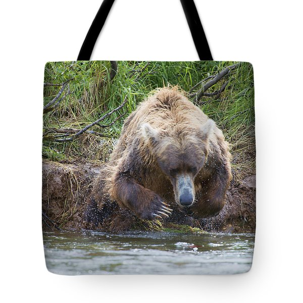 Brown Bear Diving Into The Water After The Salmon Tote Bag by Dan Friend