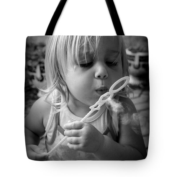 Tote Bag featuring the photograph Bubble Fun by Laurie Perry