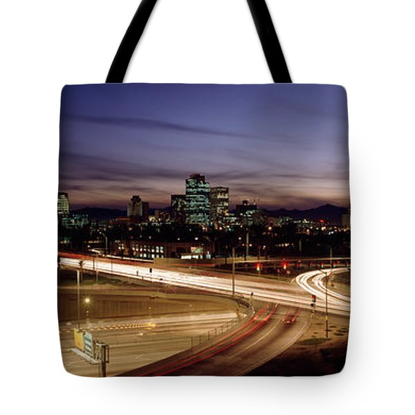 Buildings In A City Lit Up At Dusk, 7th Tote Bag