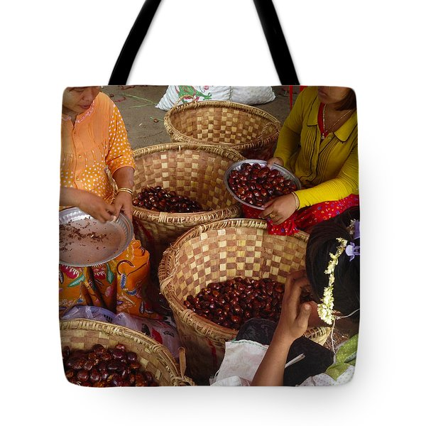 Tote Bag featuring the photograph Burmese Ladies Sorting Water Chestnuts Zay Cho Street Market 29th Street Mandalay Burma by Ralph A  Ledergerber-Photography