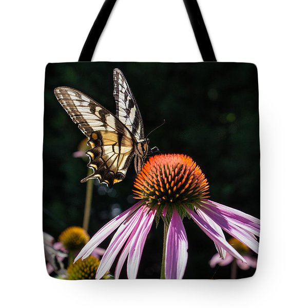 Tote Bag featuring the photograph Butterfly In The Garden by Glenn DiPaola