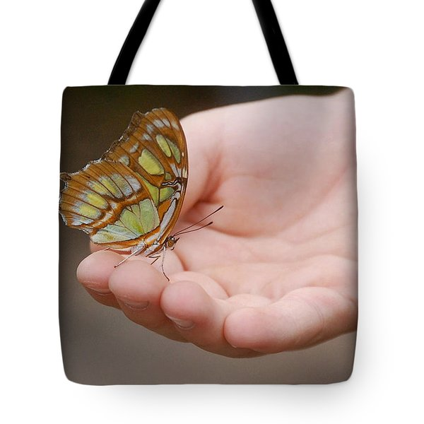 Tote Bag featuring the photograph Butterfly On Hand by Leticia Latocki