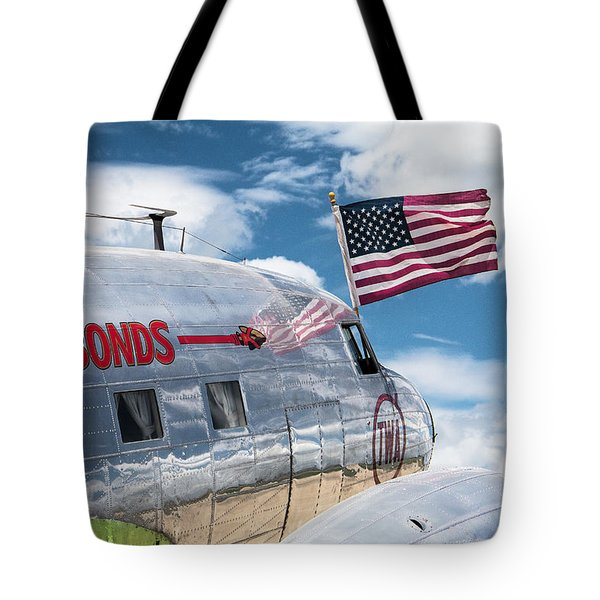 Tote Bag featuring the photograph Buy Bonds by Steven Bateson