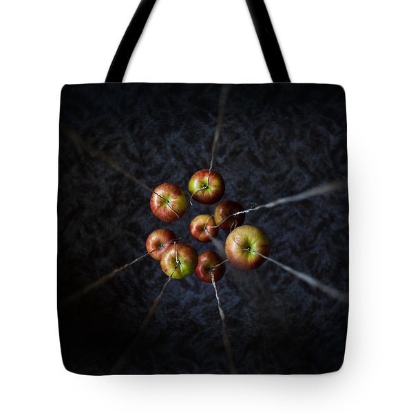 Tote Bag featuring the photograph By A Thread by Aaron Aldrich