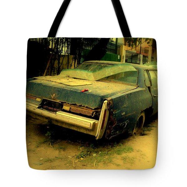 Tote Bag featuring the photograph Cadillac Wreck by Salman Ravish
