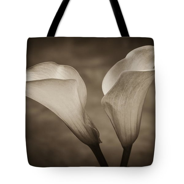 Tote Bag featuring the photograph Calla Lilies In Sepia by Sebastian Musial