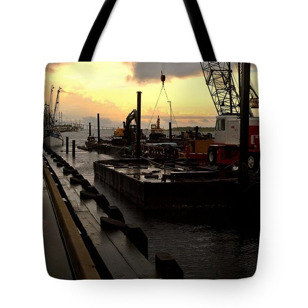 Tote Bag featuring the photograph 'cane's Comin' by Laura Ragland
