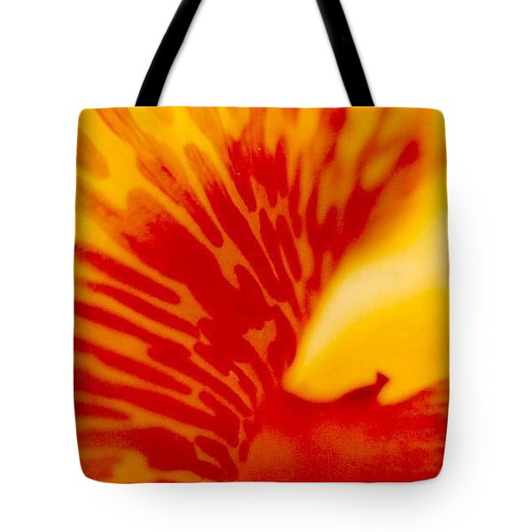 Tote Bag featuring the photograph Canna Lilly by Michael Hoard