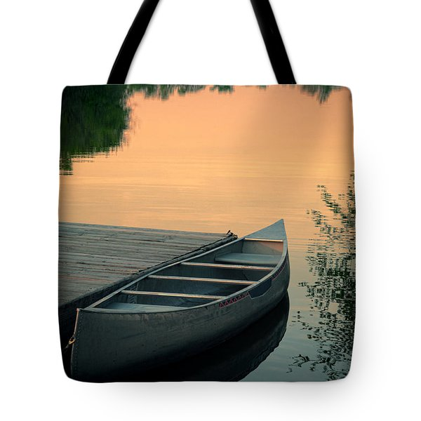 Canoe At A Dock At Sunset Tote Bag by Jill Battaglia