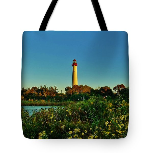 Cape May Lighthouse Above The Flowers Tote Bag by Ed Sweeney