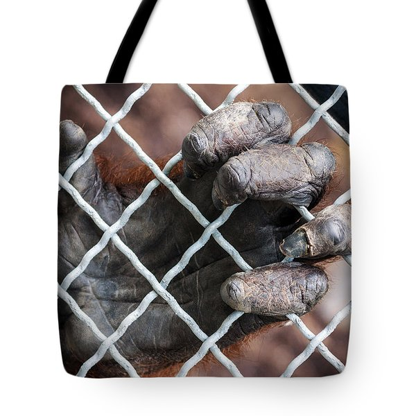 Tote Bag featuring the photograph Captive Heart by Sennie Pierson