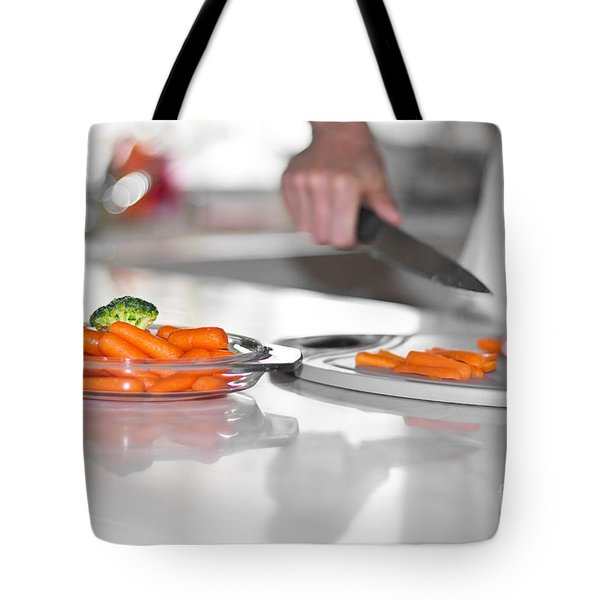 Tote Bag featuring the photograph Carrot Cutting In Kitchen by Gunter Nezhoda