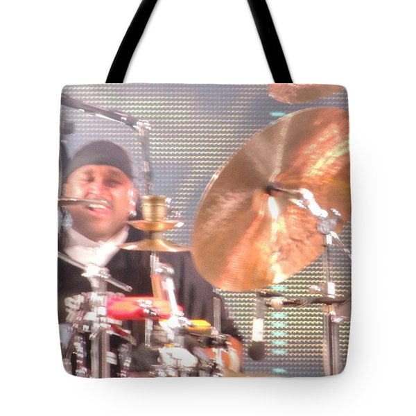 Tote Bag featuring the photograph Carter Doing What He Does Best by Aaron Martens