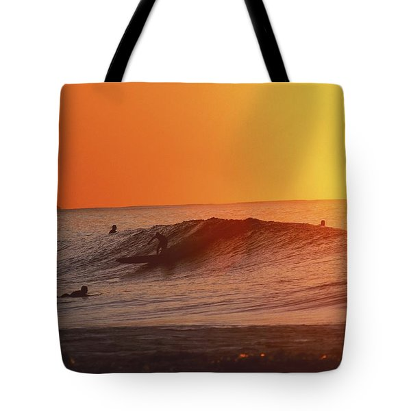 Catching A Wave At Sunset Tote Bag by Vince Cavataio - Printscapes