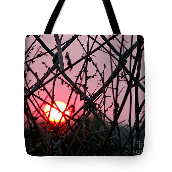 Tote Bag featuring the photograph Chain Link Sunset by Jennie Breeze