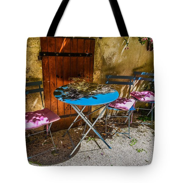 Tote Bag featuring the photograph On The Patio by Dany Lison