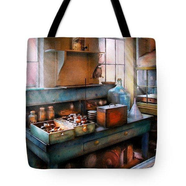 Chemist - Making Glue Tote Bag by Mike Savad