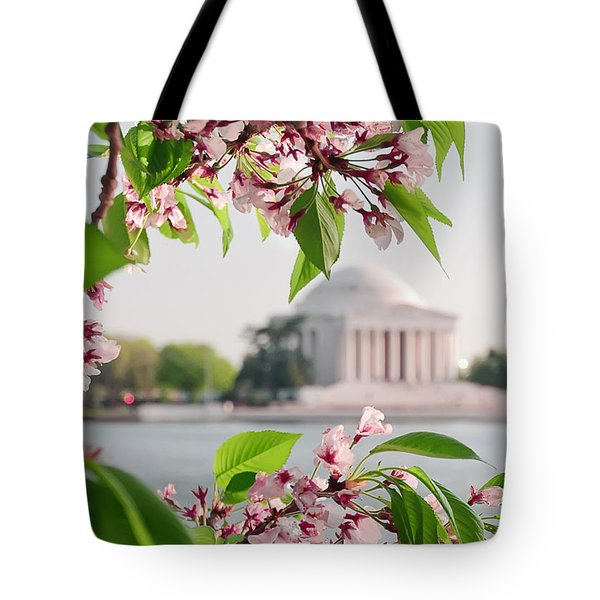Tote Bag featuring the photograph Cherry Blossoms And The Jefferson Memorial by Mitchell R Grosky