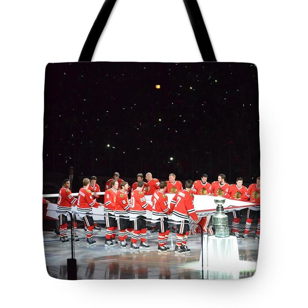 Tote Bag featuring the photograph Chicago Blackhawks And The Banner by Melissa Goodrich